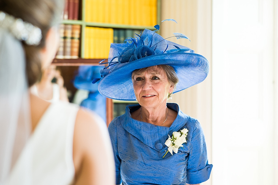 Mother of bride wearing blue outfit first look seeing bride