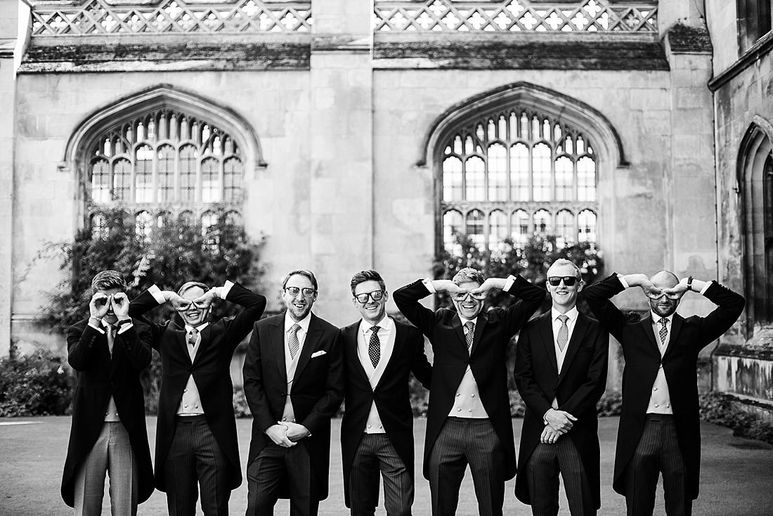 Fun group wedding picture groom with groomsmen