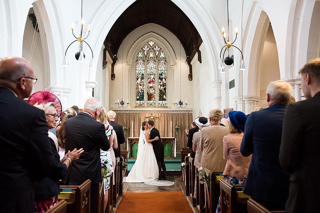 Elegant St Bene'ts Church wedding ceremony