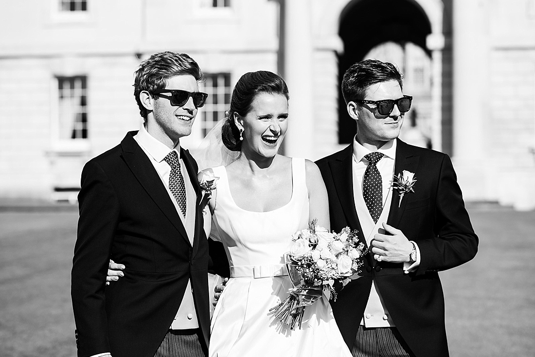 Suzanne Neville bride with two grooms