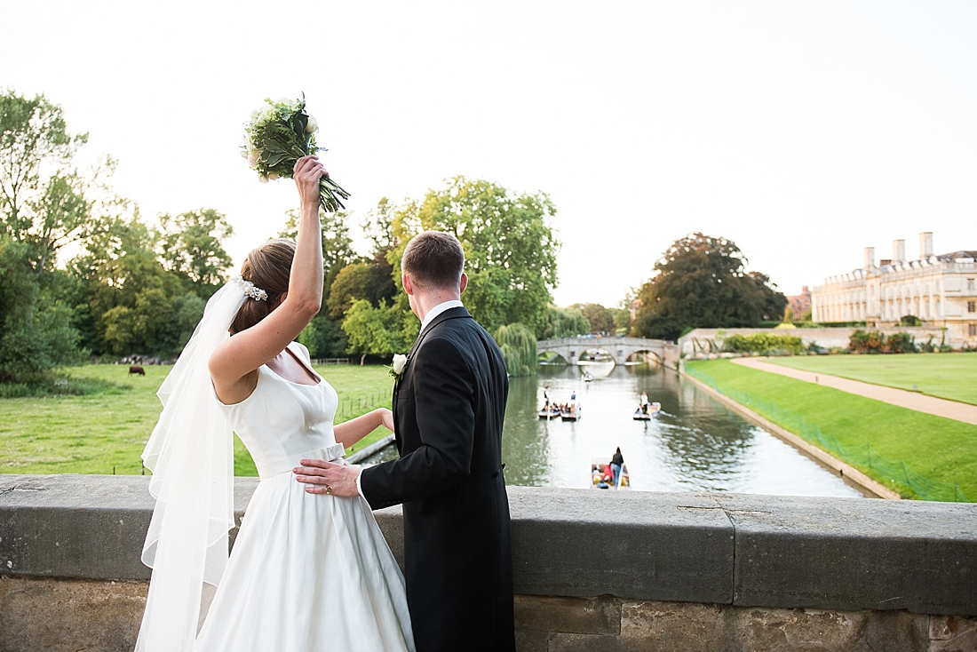 Suzanne Neville bride with groom outdoor bouquet throwing