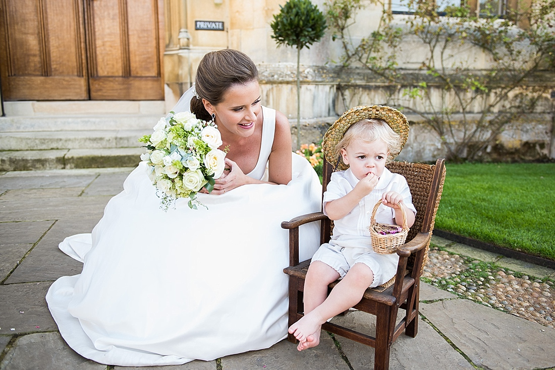 Suzanne Neville bride with cute little boy Kings College wedding