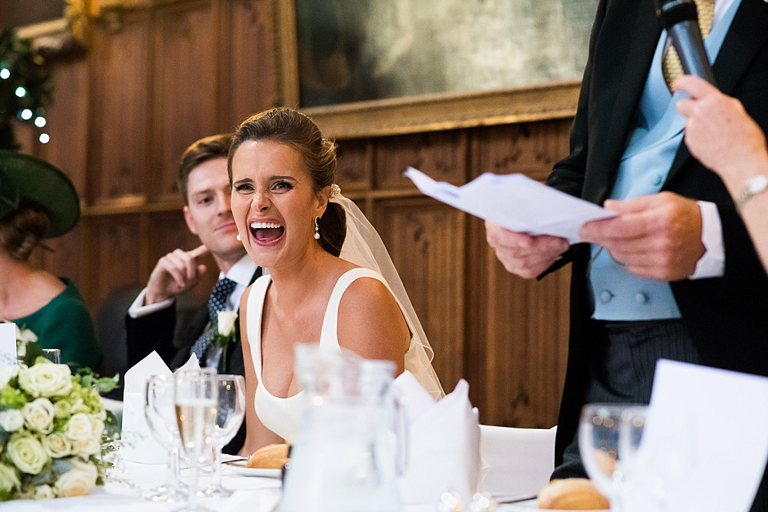 Laughing Suzanne Neville bride during wedding speech