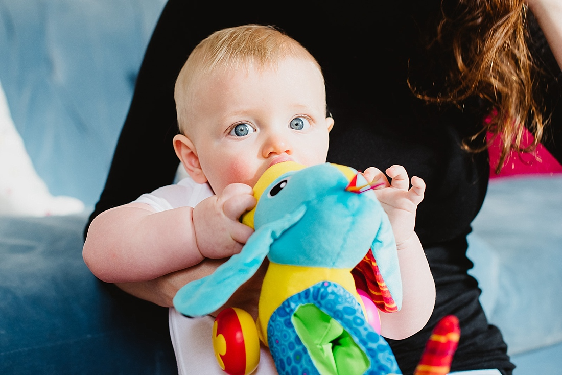 Adorable blue eyed baby with toy capturing your family story