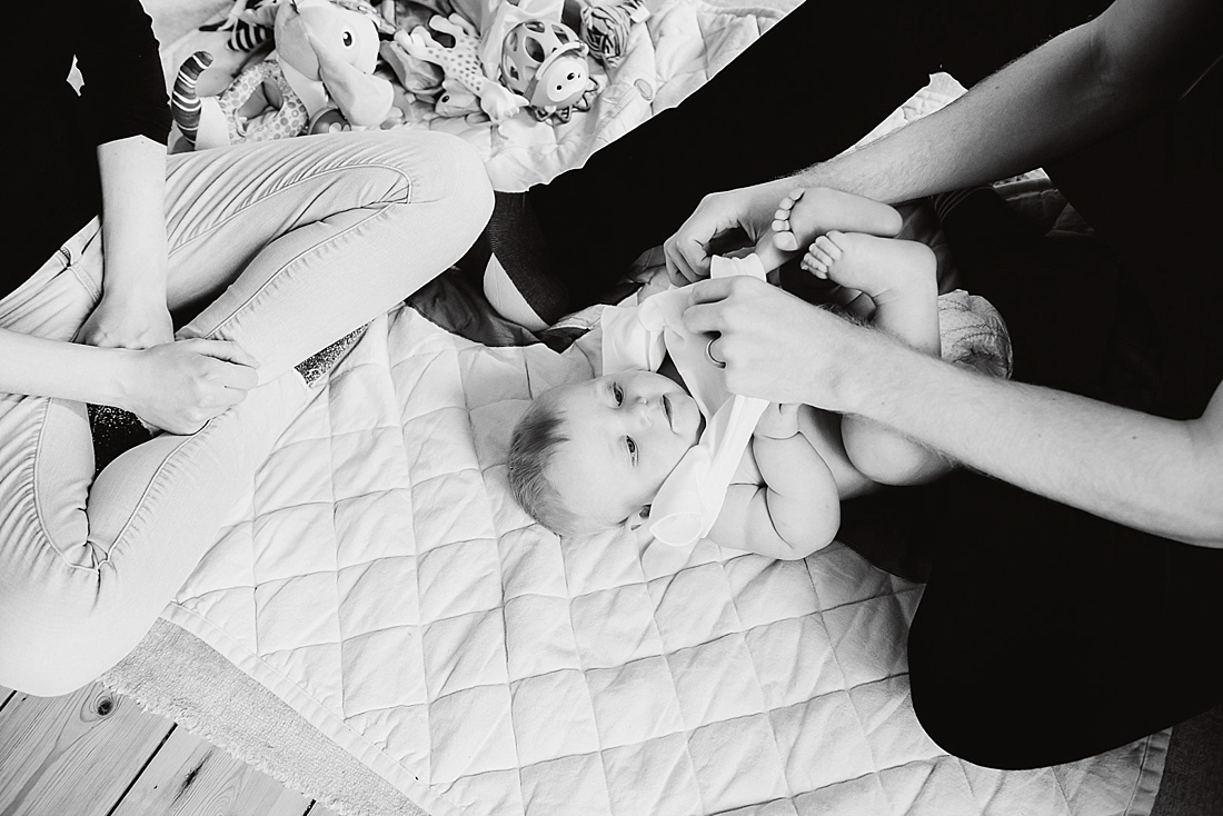 Natural family photography baby relaxed with parents London