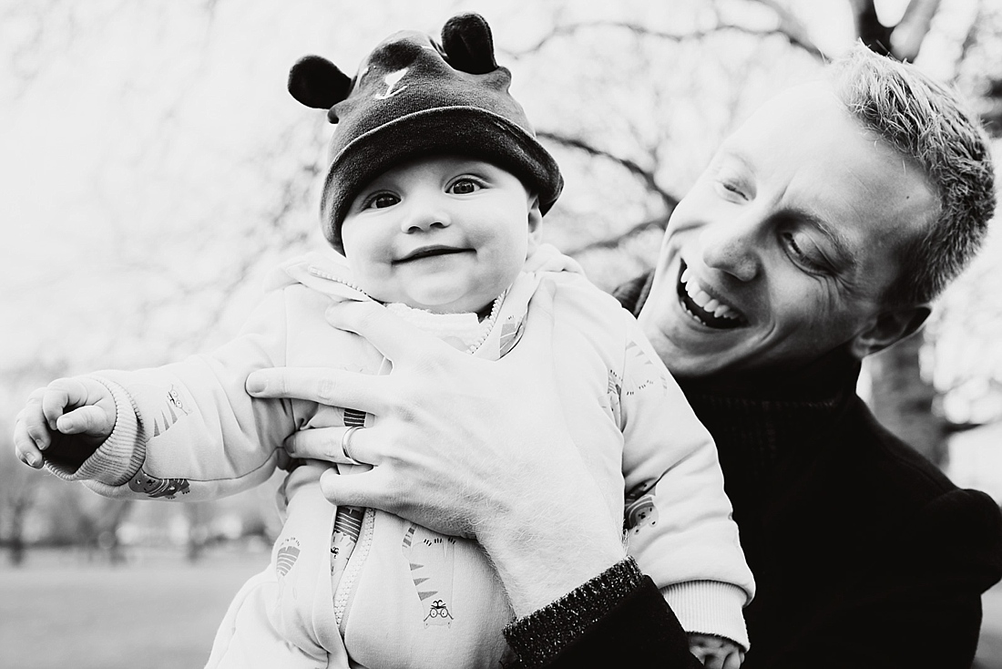 Beautiful and honest imagery smiling baby with Dad in London park
