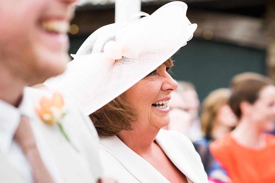Smiling Mum with best man watch wedding ceremony