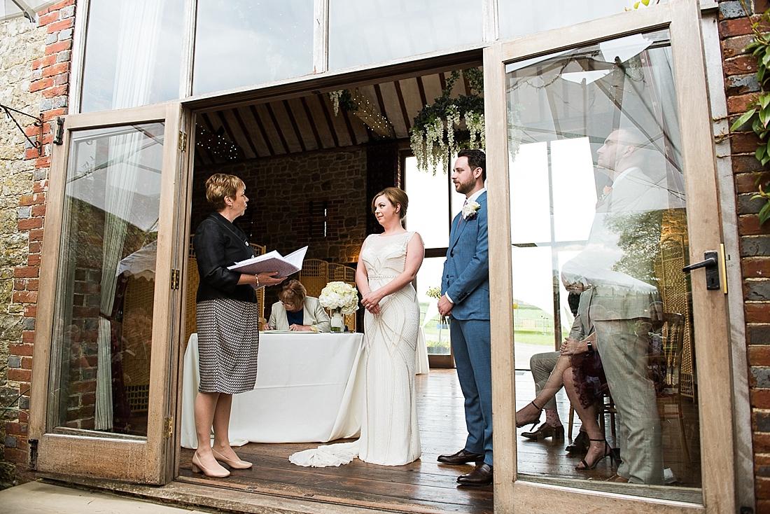 Rosa Clara bride with groom during wedding ceremony