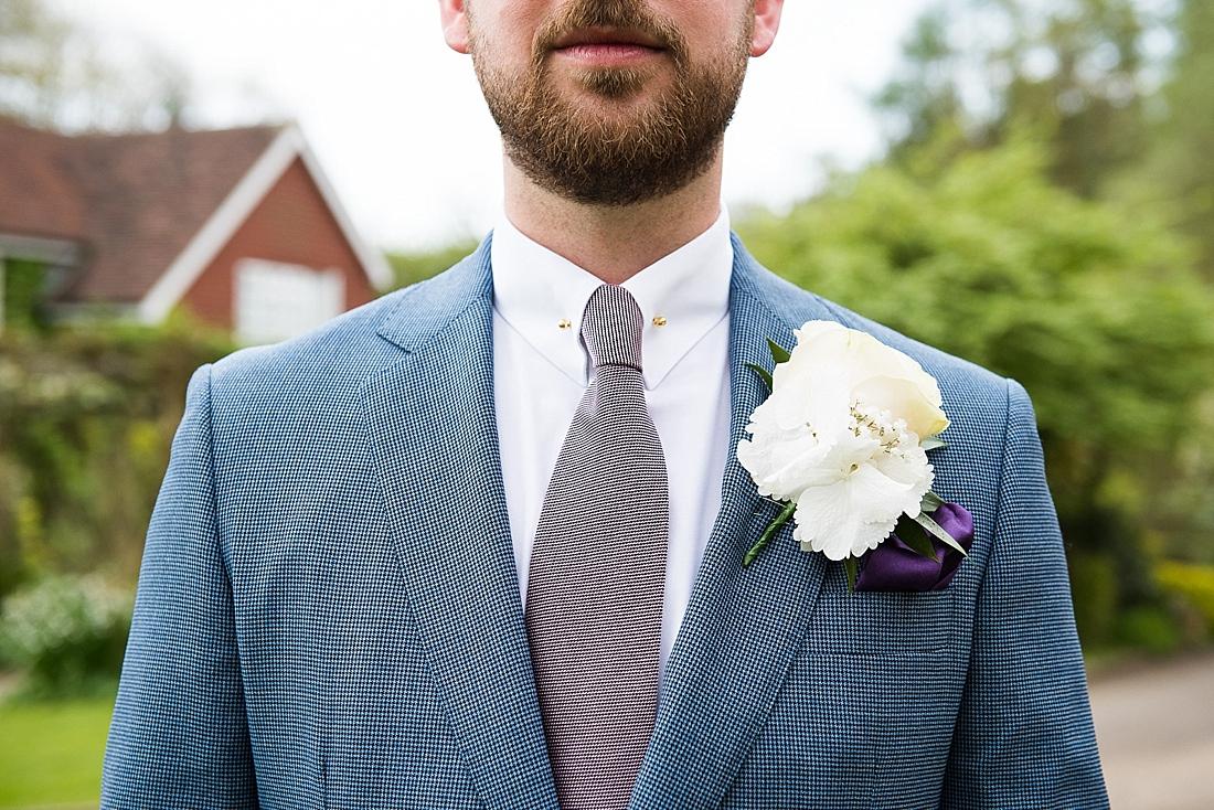 Creative Groom portrait wearing blue suit