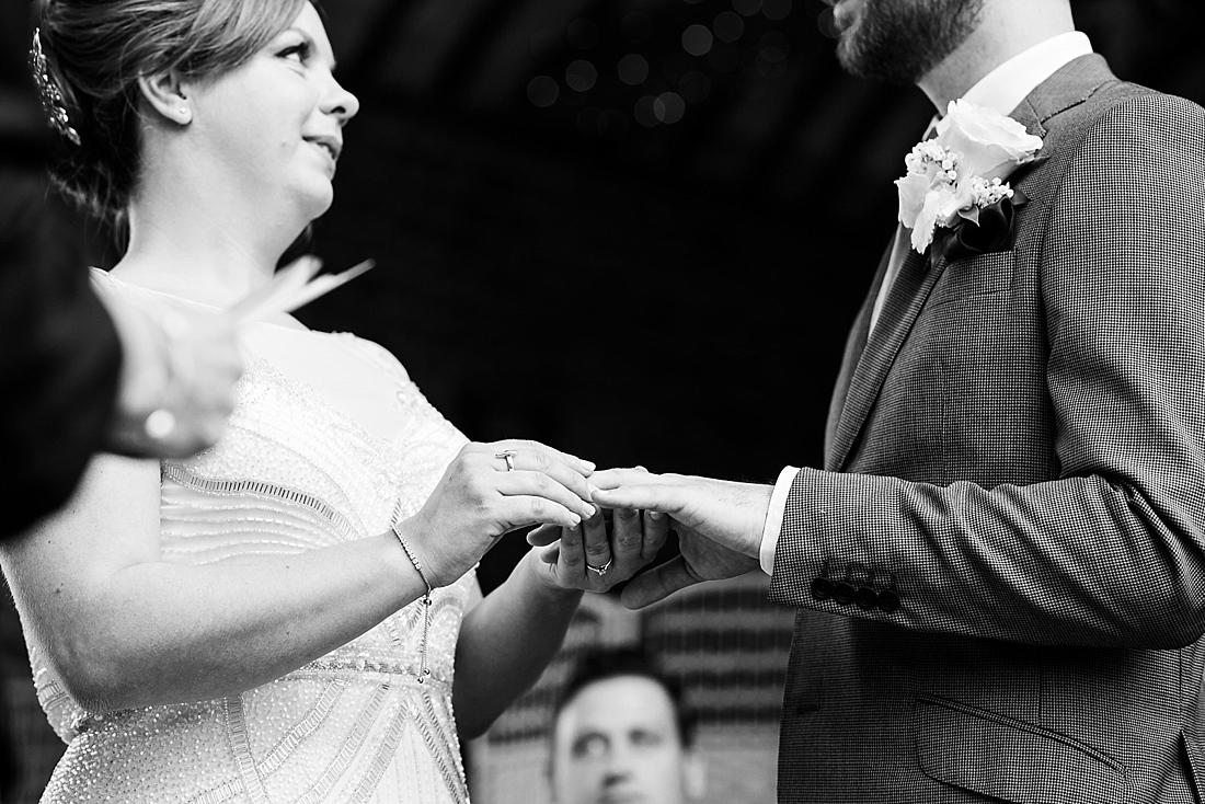 Captured moment wedding ring exchange