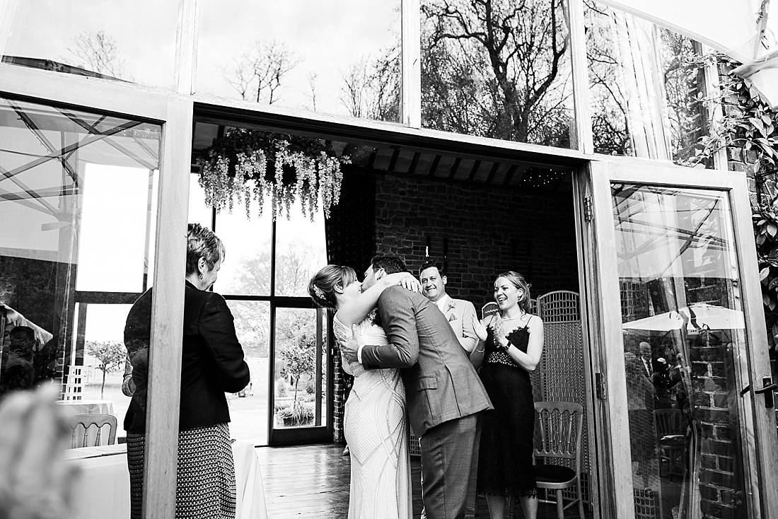 First married kiss for Rosa Clara bride with groom