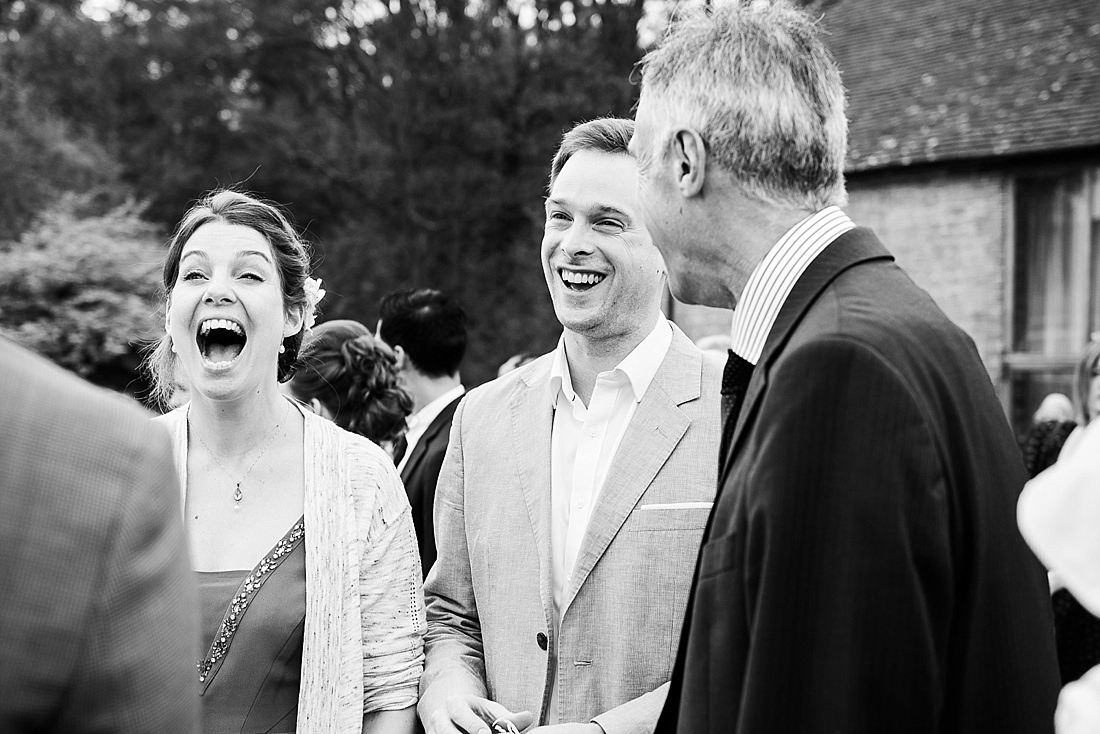 Happy wedding guests relaxed wedding photography