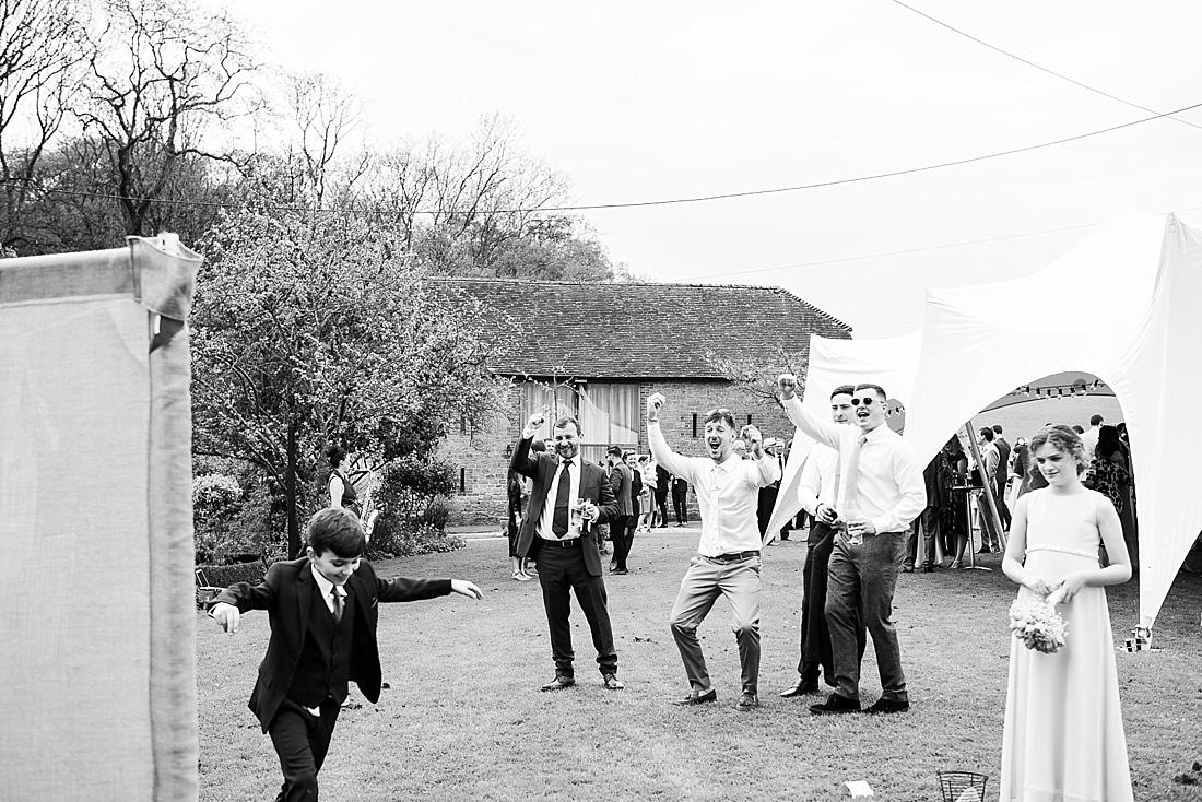 Wedding guests cheer at outdoor fun game
