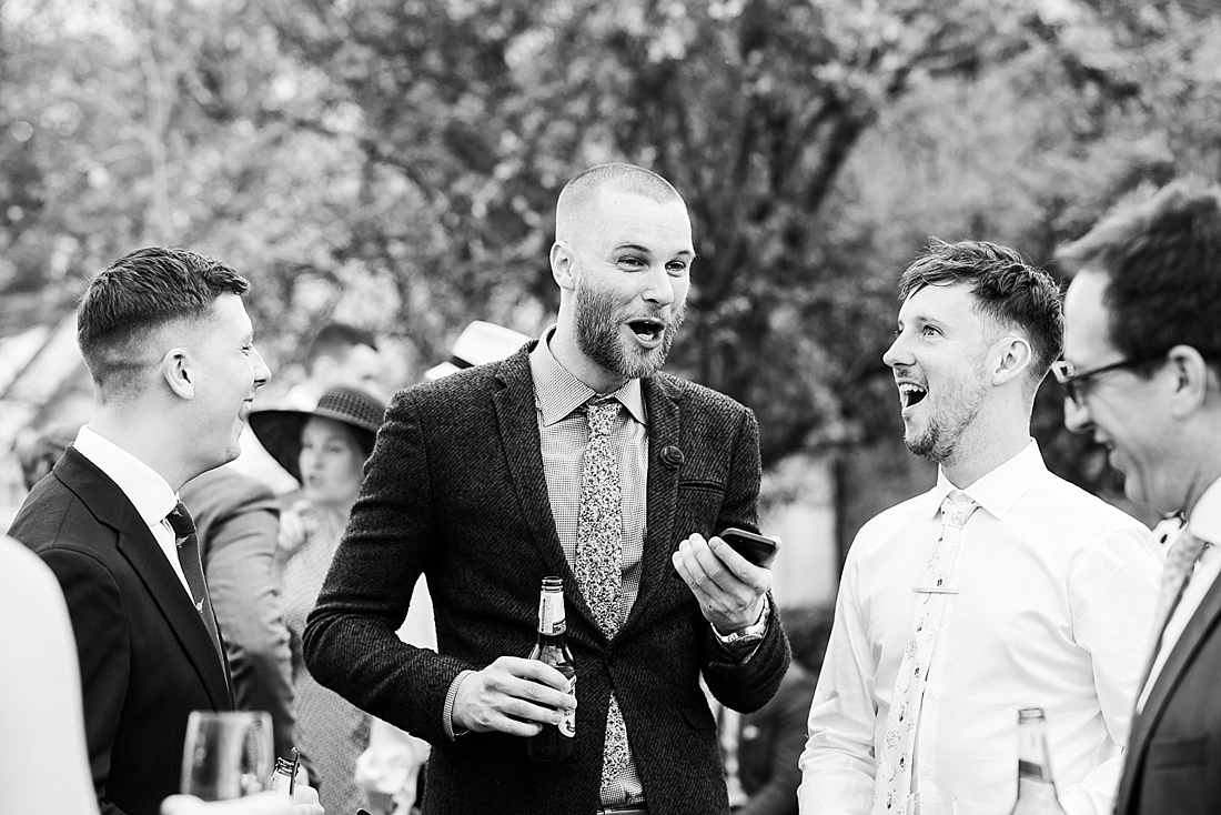 Laughter during relaxed outdoor wedding