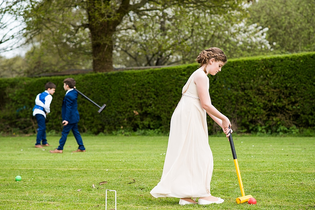 Flower girl plays croquet