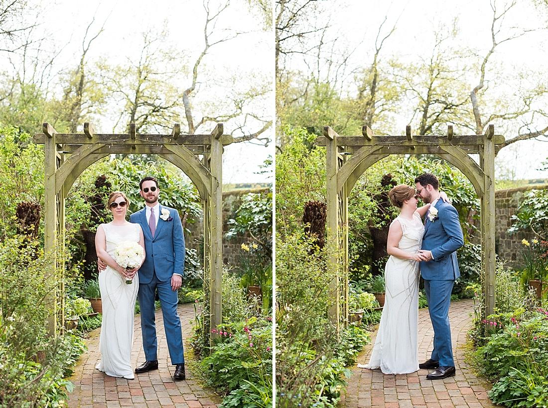 Rosa Clara bride with groom garden wedding portrait