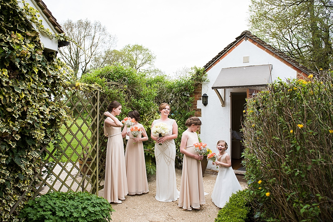Rosa Clara bride stood patiently with bridesmaids and flower girl