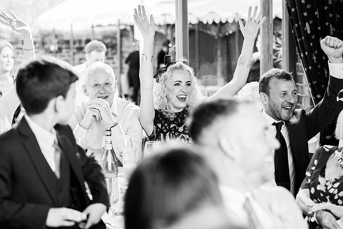 Wedding guest with hands up