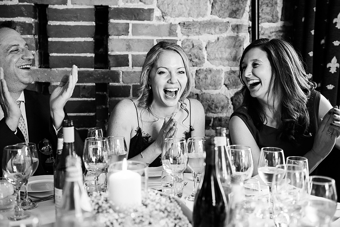 Capturing your wedding story laughter during wedding speech
