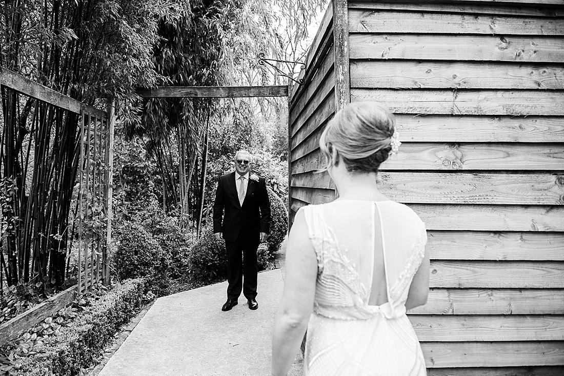 First look happy Dad greets bride before wedding