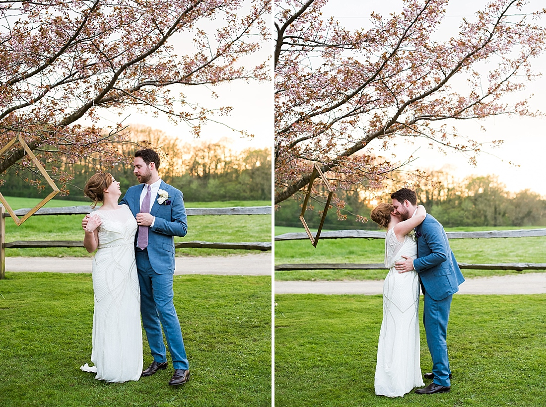 Rosa Clara bride with groom wearing blue suit