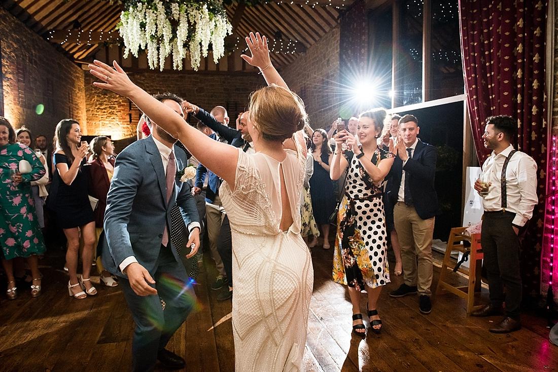 Rosa Clara bride dancing with groom fun wedding dance