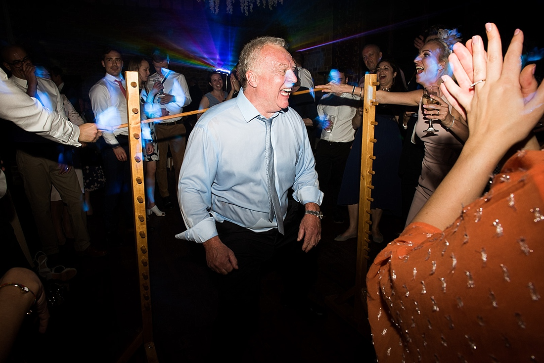 Wedding guest happy with limbo dance