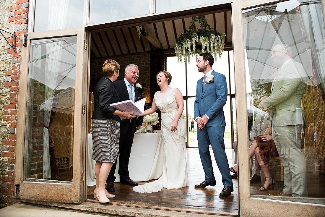 Rosa Clara bride with Dad and groom during wedding ceremony
