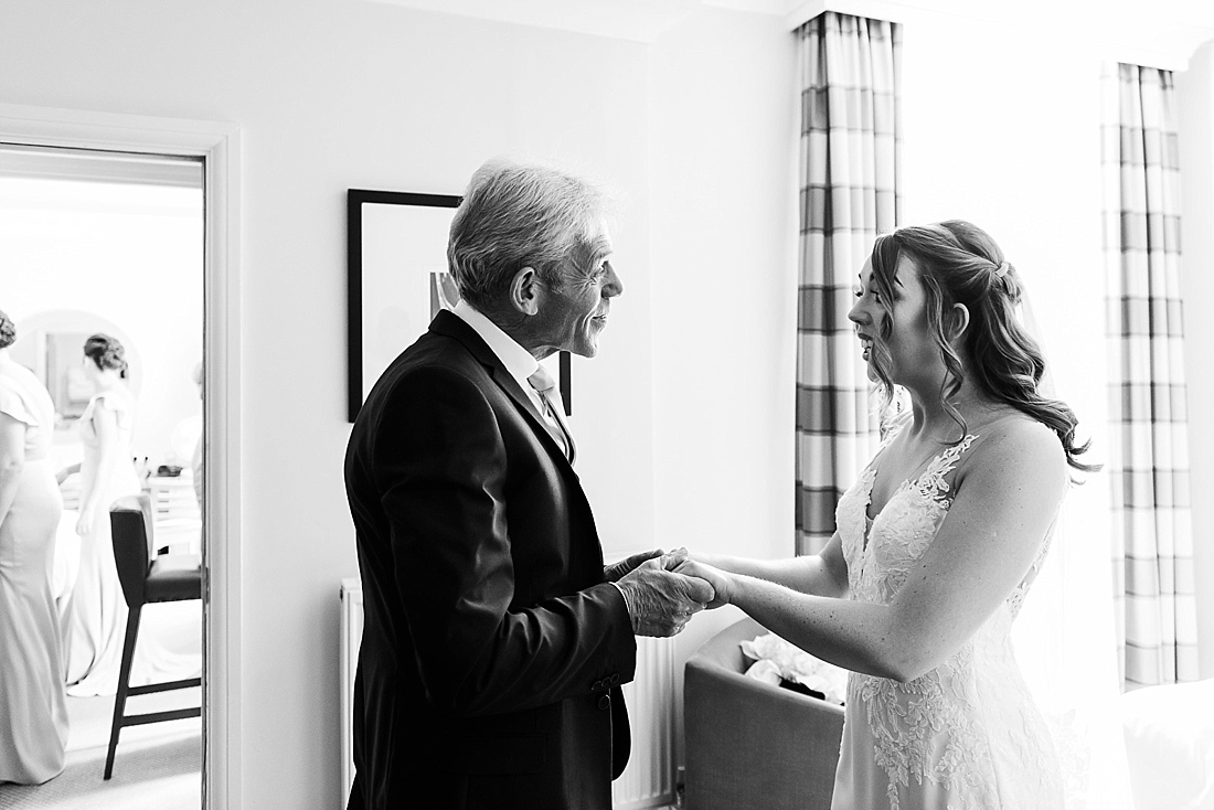 Father of the bride talking to daughter