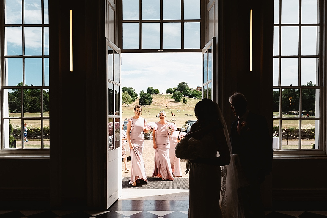 pastel pink bridesmaids arrive at Queens House