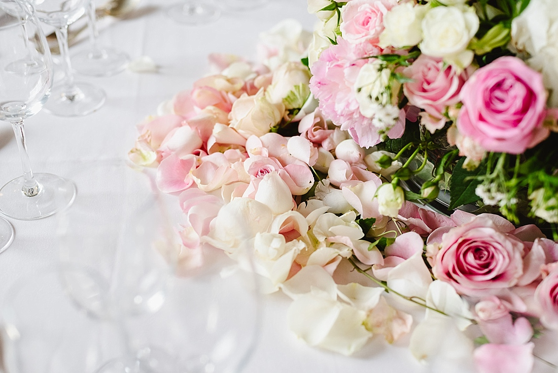 soft pink and white rose petals wedding centrepiece
