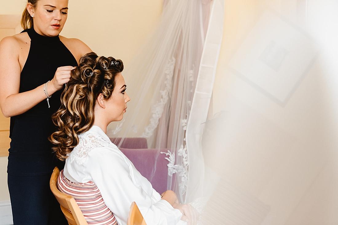 hair in curlers wedding prep