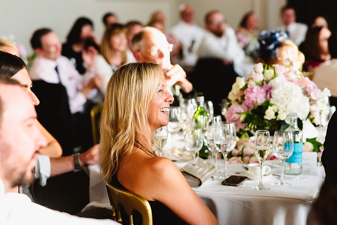 Laughing wedding guest London