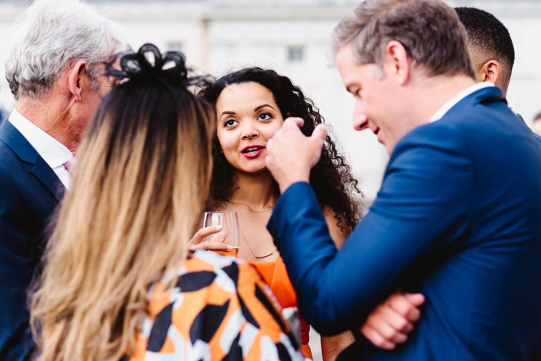 Wedding guests talking London