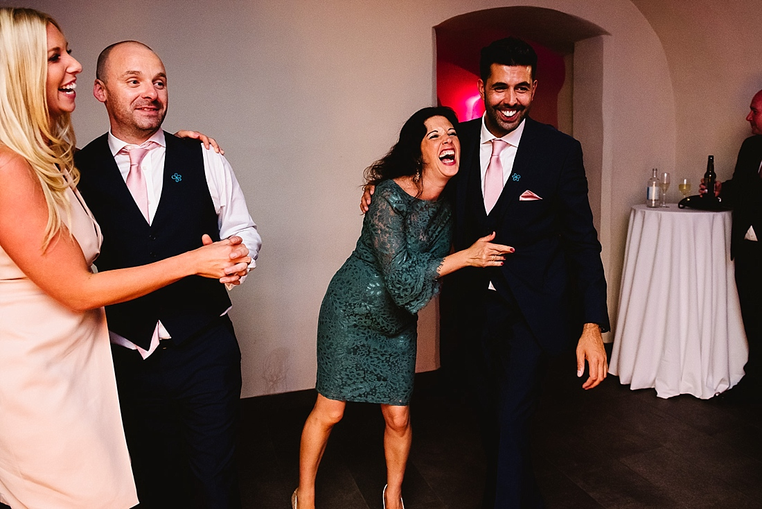 Laughing wedding guests London